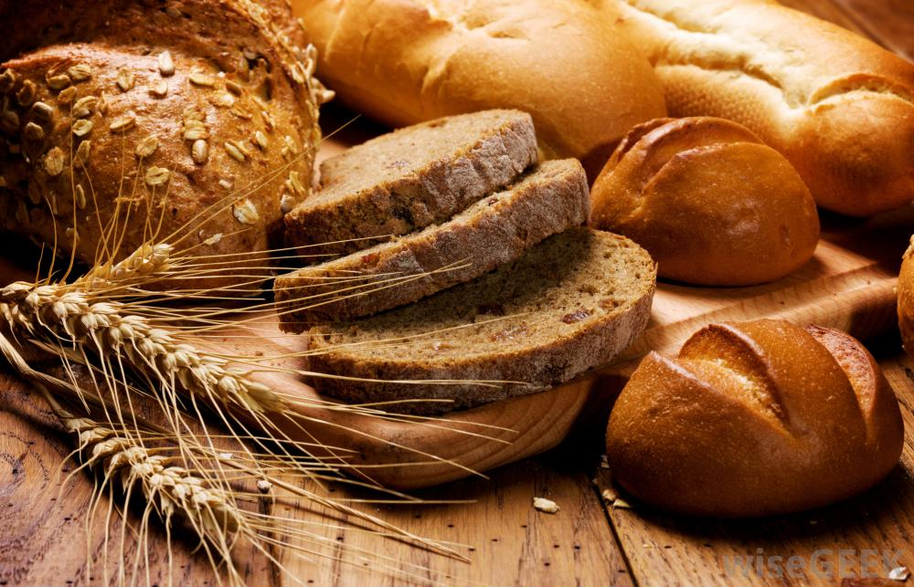 group-of-breads-on-wooden-table
