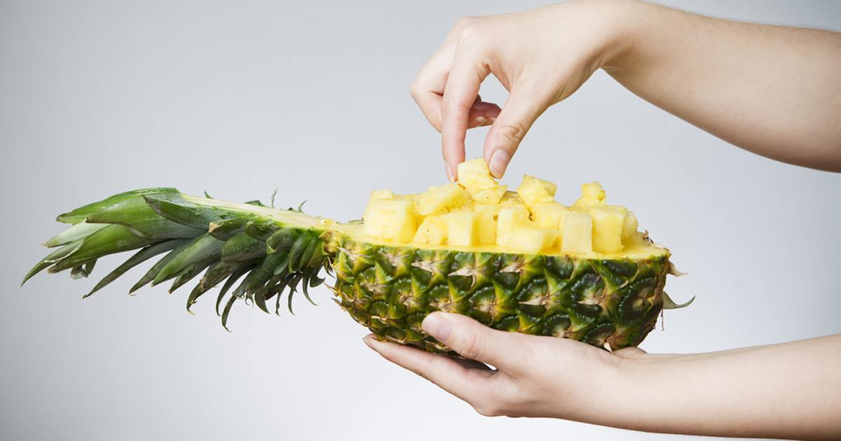 hands-holding-a-half-pineapple-facebook